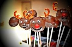 Reindeer Cake Pops! Make a basic cake pop, use dark brown candy coating for the base color of the deer, red/brown M's for the nose, white icing for the eyes, an eatable black marker for the pupils and mouth, the break a pretzel for antlers! Make sure to put the antlers in second, before the candy coating dries. VIOLA!