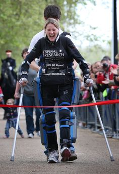Paralysed marathon runner Claire Lomas has finished The London Marathon after 16 days with the help of a bionic suit.