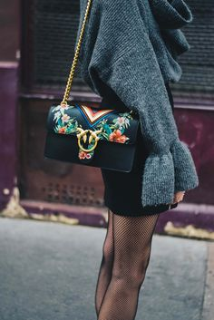 Beautiful floral detailing on this simple black purse.