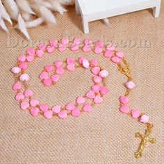 https://www.doreenbeads.com/acrylic-prayer-rosary-beads-y-shaped-lariat-necklace-heart-gold-plated-pink-at-random-64cm25-28-long-1-piece-p-119980.html
