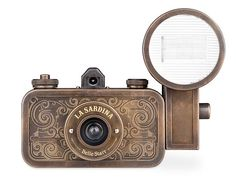 The La Sardina Belle Starr is a 35mm camera whose exterior is made from oxidized brass and finished with intricate etchings and engravings.