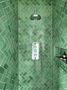 Victorian House, North London. Lined with bright green herringbone tiles, this… Drummonds