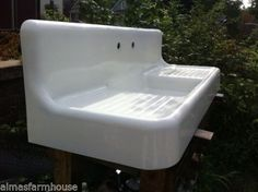 farmhouse sink with apron front and high back…
