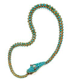 The articulated snake set with numerous graduating turquoise cabochons, the head accented by one Dutch rose-cut diamond and two cabochon garnet eyes, the eyes highlighted by small rose-cut diamonds, the snake's mouth is open to reveal sculpted gold fangs and serves as the clasp, length 15¼ inches, one turquoise missing. With fitted case signed Harvey & Gore.