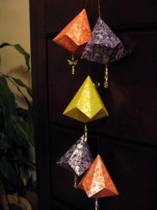 Origami bell shaped ornaments.  These are very easy and fun.  You can even stamp your own design on plain cardstock :)