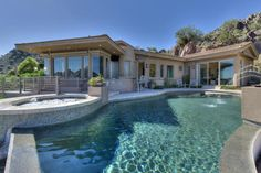 High Above on Hillside Dr Paradise Valley has a 40 foot waterfall and is completely automated asking $3,175,000