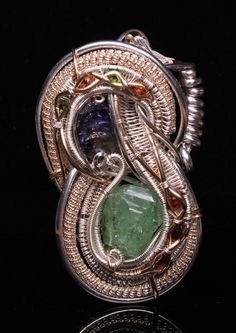Wire Wrapped Pendent, (Colors of Tanzania), love, unique, gift, Tanzanite, Tsavorite Garnet, handmade jewelry by Nick Noyes. $400.00, via Etsy.