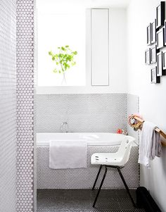The bathroom is clad in Rotondo mosaic tiles from Domus, while the Polo chair is by Robin Day – try ebay.