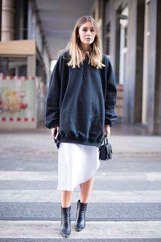 Italian blogger Chiara Capitani attends Milan Fashion Week in an oversized hoodie (a AW16 got-to-own piece), asymmetric skirt and Maison Margiela mini bag