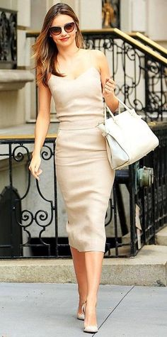 Miranda Kerr wearing Beige Midi Dress, Beige Suede Pumps, White Leather Tote Bag, Brown Sunglasses