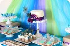 Peacock Party {unique party themes} This birthday tea party is definitely pretty as a peacock! The purple, green and blue tulle backdrop is a site to be seen. 40th Birthday Party Themes, Peacock Birthday Party, Birthday Party Celebration, Birthday Ideas, 40 Birthday, Birthday Pins, Theme Parties, Princess Theme Party, Peacock Wedding