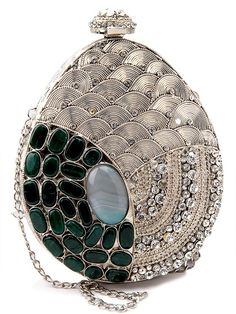 Admirable silver color brass metal #Clutch #Purse studded with green color stone and shiny diamantes will create a truly individual look.  Item Code: SJBP2017A http://www.bharatplaza.com/new-arrivals/accessories.html