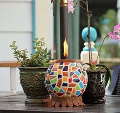 Mexican Clay Pottery Oil Lamp - Nothing ignites outdoor conversation more than this colorful tabletop torch. A favorite of our customers and staff alike, the size, weight and quality of this design are sure to please your guests as well. This handcrafted patio torch is made from a rainbow of colorful tile that will compliment any decor.