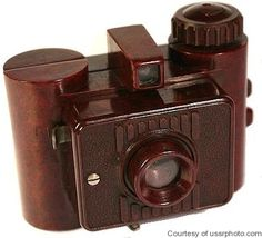 "GOMZ Liliput - c1937-1940. 35mm paper-backed film, 24x24mm exposures, bakelite camera. ""Лилипут"". Red, brown, blue or green."