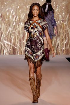 Short-sleeved purple, orange, and white print fringe mini dress and lace-up boots (Spring/Summer 2011 Ready-to-Wear Collection by Anna Sui)