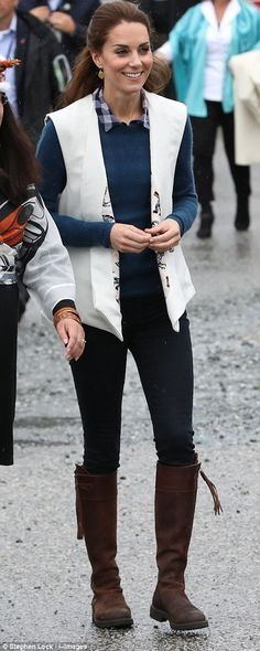 The duchess came ready for the wet weather, opting for a trusted pair of mid-length boots from Penelope Chilvers