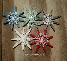 Five inch by five inch wooden glittered clothespin snowflake ornaments with attached white snowflake, set of five multiple color (blue, red, silver, white and green)// ready to add to tree or wall// available all in one color