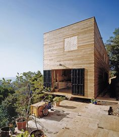 """House 205  1,690 square feet  H Arquitectes  Vacarisses, Spain    In neighboring Spain, H Arquitectes perched House 205 on a craggy slope by cutting a small ledge. According to """"Small Eco Houses,"""" the builders minimized damage to the natural environs.    The home is built with a material-saving truss system and load-bearing walls, instead of a heavy foundation. It emphasizes cross-ventilation and scenic views."""