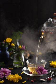 Process brewing tea, dark mood. The steam from hot tea is poured from by Angelina Zinovieva / 500px