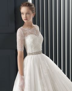 Beaded lace and tulle dress in a natural colour.