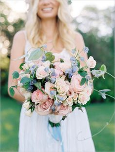 this pink, peach and blue bouquet is perfect for a springtime wedding #pinkroses #springflowers #bouquet http://www.weddingchicks.com/2013/11/07/hawaiian-engagement/