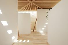 The architects worked to create a space that celebrates both light and shadow. The way that the slats in the roof allow and block sunlight and different angles turns the light itself into an artistic show inside the home.