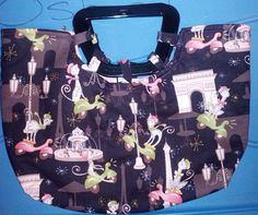 "15"" X 13"" Fabric Purse.  Features Kitties in Paris, on scooters.  Pink lining, padded.  Handmade, embellised with rhinestones.  Has plastic handles."