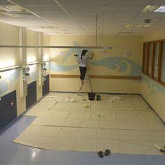 Painting the walls with an aquarium graphic. West Suffolk Hospital. Amanda Turner. Pintsizeart.com