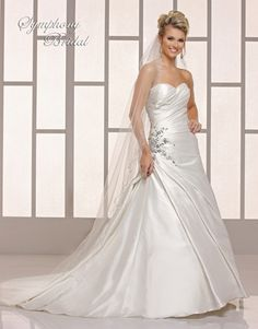 Symphony  Style #S3716  Elegant taffeta A-line gown for the bride has a sweetheart neckline and pleated bodice and skirt. There is a unique beaded lace appliqué on the right hip area. There are covered buttons over the zipper and a court train.