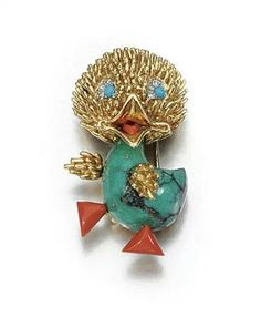 GEM-SET AND DIAMOND BROOCH, VAN CLEEF & ARPELS, 1960s Designed as a duck, carved Turquoise body, Coral feet and tongue, the eyes of cabochon Turquoise highlighted with single-cut Diamonds, signed Van Cleef & Arpels and numbered.
