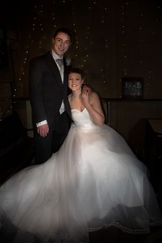 Bride and groom portrait at night with fairy lights