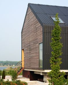 anthracite-coloured corrugated sheets by JagerJanssen architects BNA