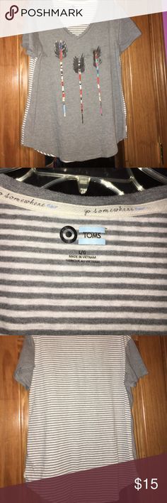 TOMS T-shirt Gray TOMS t-shirt. With gray and white stripes on the back and some feather arrows in the front. Good condition. TOMS Tops Tees - Short Sleeve