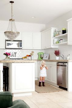 This kitchen has granite like ours- so here's how ours might look with white cabinets. So pretty.