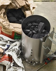 Using a chimney starter is the best way to light a charcoal grill. Never use lighter fluid, as its odor and chemical components can penetrate your food. Place a few sheets of crumpled newspaper inside the bottom of the cylinder and fill to the brim with charcoal.