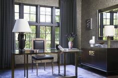 """The graphic wallpaper works with the small scale of the space,"""" Moran says of his office, """"and there weren't that many other places where it'd make sense."""" A modern yet traditional chair, a contemporary brass desk, and his ever-present art pottery complete the look. """"All of the different textures relate nicely,"""" says Moran. Photo: Jessica Sample"""