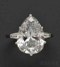 Platinum and Diamond Solitaire, Mounted by Cartier   Sale Number 2539B, Lot Number 694   Skinner Auctioneers