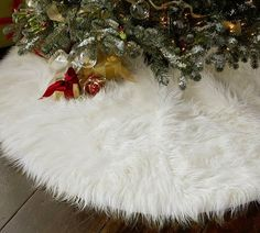 Use those cheap, faux sheepskin rugs from IKEA and toss casually under the tree for an inexpensive skirt.