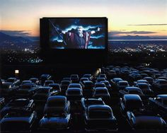 <b>1958</b> | On the screen of a drive-in theater in Utah, Charlton Heston, as Moses in the The Ten Commandments, throws his arms wide before what appears to be a congregation of cars at prayer. Originally published in the December 22, 1958, issue of LIFE.