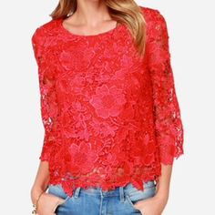 Red Lace Top Woven floral lace covers this top in a rich red hue, from the rounded neckline to the scalloped bottom hem. Long sheer 3/4 sleeves bell out slightly towards scalloped cuffs. Bodice is lined in stretch knit. Fit is very tight by bust..Not ideal for larger chested girls..100%polyester BRAND NEW ..Never Worn..Ordered online..*Did not come w/ attached tags* Lulu's Tops