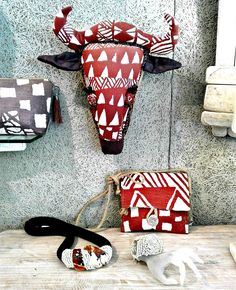 Shop our collection of textile hunting trophies. These unique trophy-style designs feature African animals including Antelope, Elephant, Giraffe and Zebra. Handmade in South Africa from hand-printed fabrics and organic materials. Hand Printed Fabric, Printing On Fabric, Giraffe, Elephant, African Jewelry, African Animals, Craft Stores, Textile Art, Jewelry Crafts
