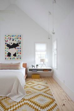 including the panda art :) Wall art and chic rug add color and pattern to the stylish Scandinavian bedroom [Design: Texas Construction Company] Scandinavian Bedroom Decor, Scandi Bedroom, Scandinavian Style, Wooden Platform Bed, Decoration Chic, Modern Bedroom Design, Bedroom Designs, Bedroom Ideas, Bedroom Styles