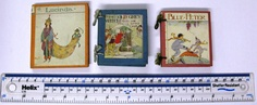 We have a number of tiny children's books which were easier for small hands to hold and could be used to make sure that children were 'seen and not heard' when out in public.