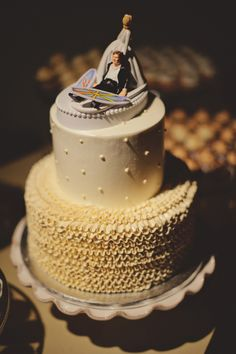 For a 'vintage surf wedding' - surf boards in the cake topper, pearls and scalloped frosting on the cake!