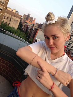 miley-cyrus-arm-typography-tattoos-pictures