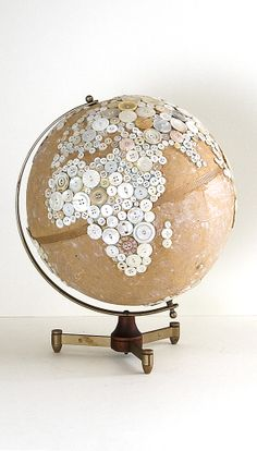 "Robin Ayres – 12"" button globe. All the but are sewn on."