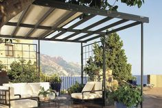 retractable roof pergola canopy looking for a patio treatment that will work for all seasons. Black Bedroom Furniture Sets. Home Design Ideas