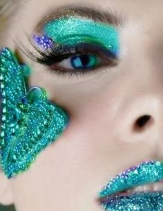 Sparkly crystal accented turquoise eyes and lips.