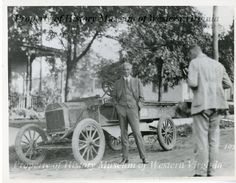 1918 photograph of Henry Ford standing by an automobile.  From a two week camping trip taken in 1918 by Henry Ford, Harvey Firestone, Thomas A. Edison, and John Burroughs.  (History Museum of Western Virginia)