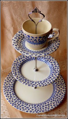 """Blue and white three tier cake stand made of English Ironstone Tableware Provence Blue (aka """"Blue Rose Chintz"""") vintage plates - truly """"cottage chic"""" masterpiece to accompany your tea party in exquisite and tasteful way available from Posh&Seductive Etsy boutique store. Get hold on one to impress!"""